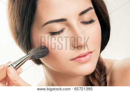 Makeup Applying  closeup. Cosmetic Powder Brush. Perfect Skin