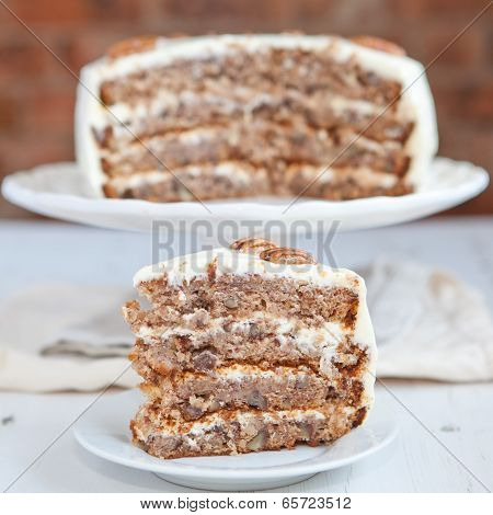 A Piece Of Hummingbird Cake With Pecans And Cream Cheese Frosting