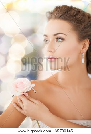 bride and wedding concept - young woman with rose flower
