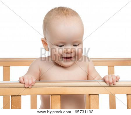Infant Child Baby Boy In Wooden Bed Looking Down