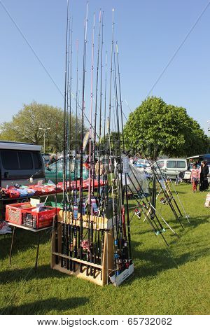 A carboot sale with fishing rods for sale