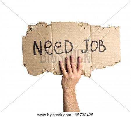 Hand holding corrugated cardboard torn