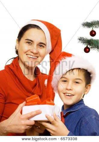 Mother With Her Son At Christmas Time
