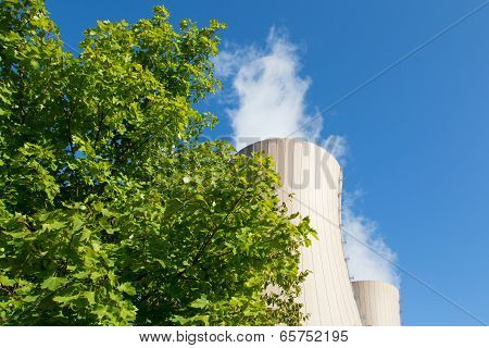 Green Tree Branches Against A Nuclear Power Plant
