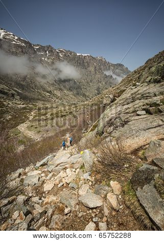 Hikers In The Mountains Of Restonica In Corsica