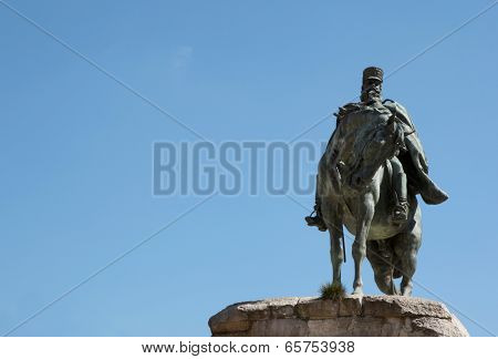 Sculpture Of A Horseman With Blue Sky Background