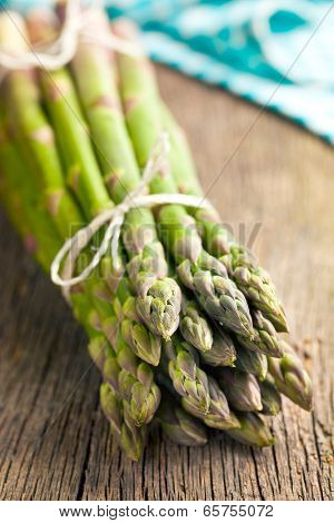 green asparagus on old wooden table