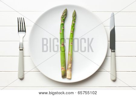 top view of green asparagus on white plate