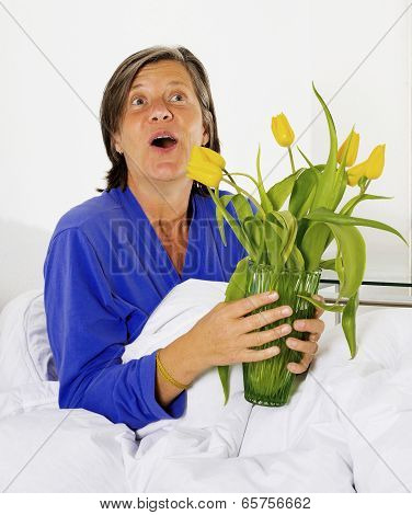 Woman In Bed With Flowers