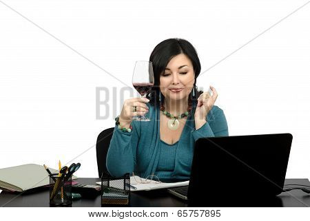 Mature Businesswoman Celebrating Her Success With Glass Wine