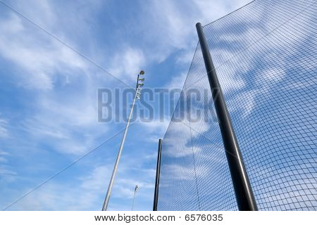 Baseball Net And Stadium Lights Abstract