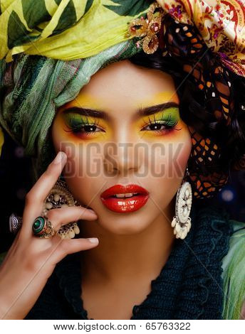 beauty bright woman with creative make up, many shawls on head like cubian woman