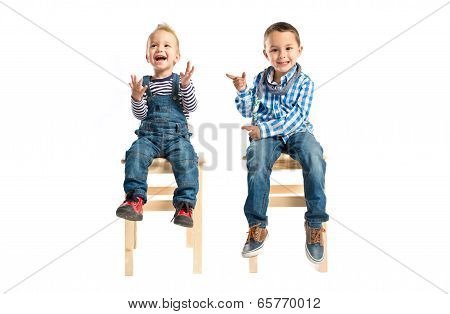 Kids Clapping And Pointing Over White Background