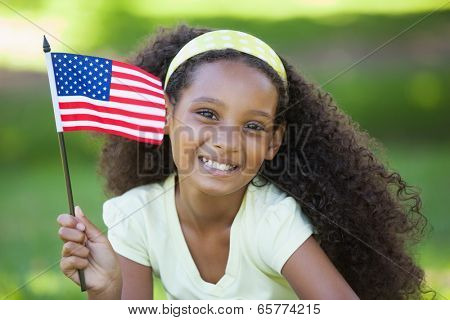 Young girl celebrating independence day in the park on a sunny day