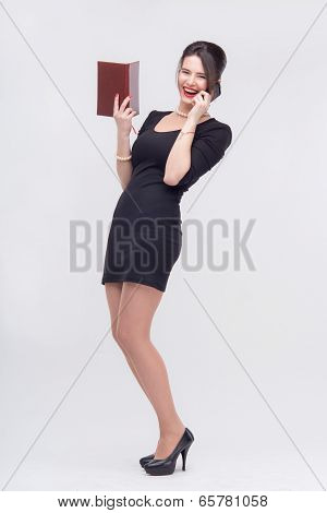 Pretty business lady standing with book
