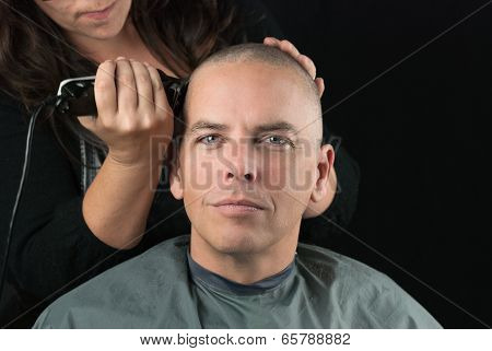 Stylist Shaves Mans Head