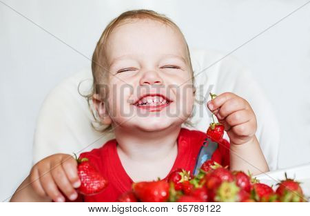 Happy Toddler Boy Eating Strawberries