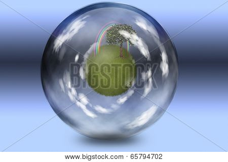 Grassy sphere with tree and rainbow enclosed in glass sphere