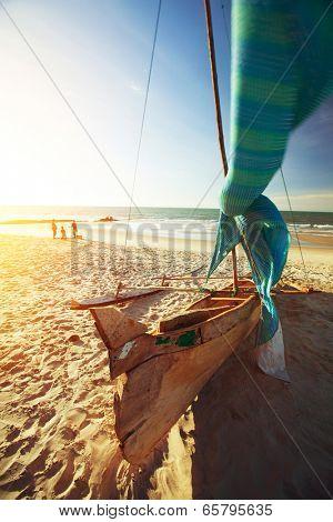 Traditional Malagasy sail boat on sandy beach. Morondava, Madagascar