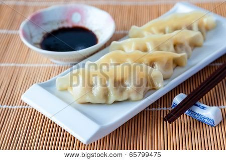 Delicious Gyoza Or Pot Stickers On Bamboo Mat