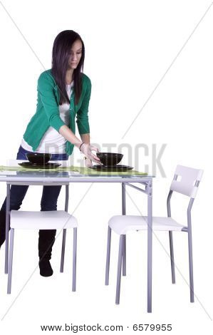 Beautiful Teenager Preparing The Table