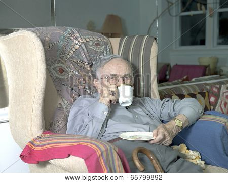 Senior Man Sitting With Drinking Cup