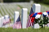stock photo of corps  - veterans cemetery memorial celebration with American Flag - JPG