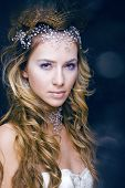 stock photo of snow queen  - beauty young snow queen in fairy flashes with crown on her head - JPG