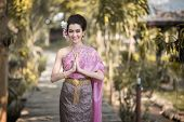 image of polite girl  - Beautiful Thai girl in Thai traditional costume - JPG