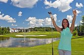 pic of ladies golf  - Happy woman on the faireway of a golf course - JPG