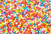 foto of jimmy  - colorful sweet sugar spreading pastry decoration background  - JPG