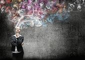 foto of start over  - Young pretty businesswoman thinking over the ideas - JPG