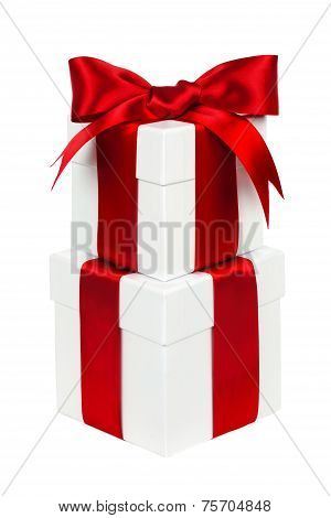 Stacked white and red Christmas gift boxes isolated