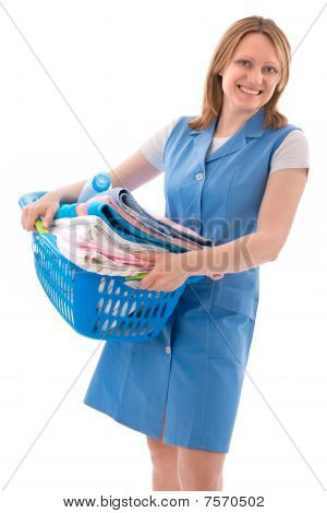 woman holds basket of laundry