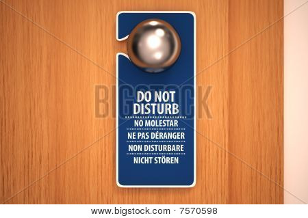 Do not disturb sign on a door knob