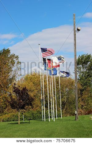 Flags on Poles in Fall