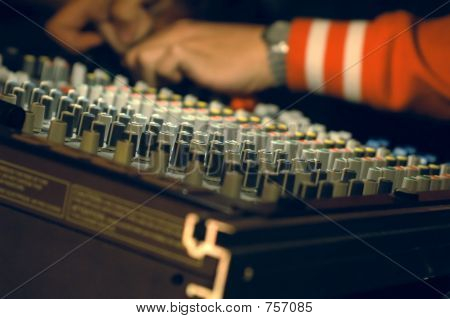 Musician mixing on audio board