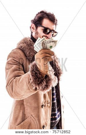 young man holding dollars