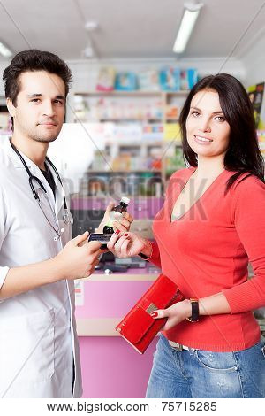 Pharmacist And Client With Products