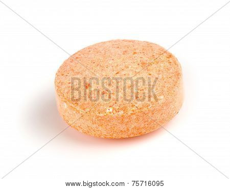 Macro Closeup Of Orange Vitamin C Chewable Tablet Isolated On White
