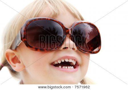 Cute little girl wearing sunglasses