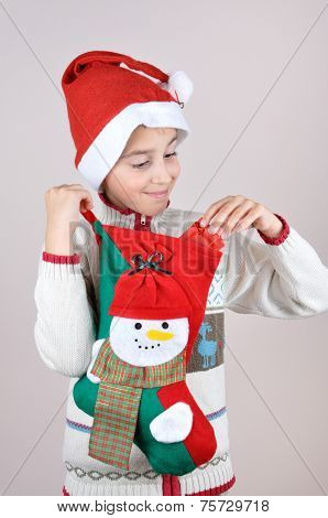 Young boy looking at Christmas present