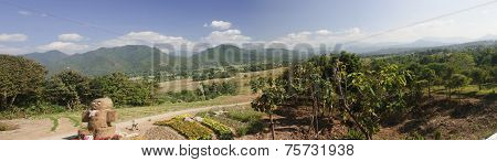 A View Of Fields And Mountains In The Village Of Pai - Thailand.