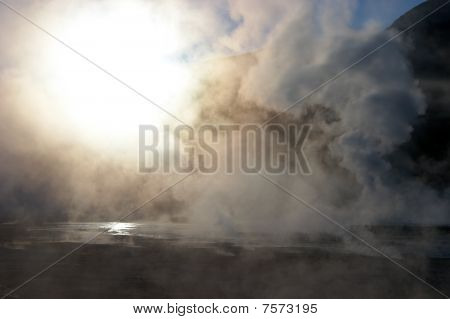 Sun Shining Through Steam At Geyser Field, Chile