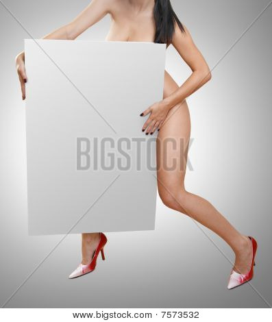 Nude woman with blank sign