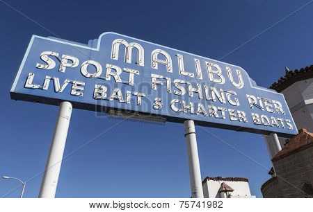 MALIBU, CALIFORNIA, USA - November 7, 2014:  Famous vintage Malibu Sport Fishing Pier sign on Pacific Coast Highway in Southern California.