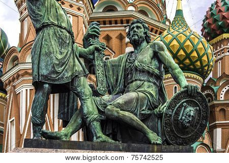 Monument to Minin and Pozharsky on the Red Square in Moscow Russia. Saint Basil's Cathedral on the background.