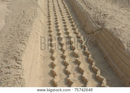 Heavy vehicle tire track on thick dust