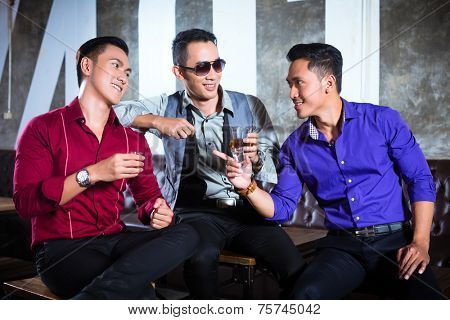 Asian party people man harass woman with her boyfriend in night club by inviting her to a drink