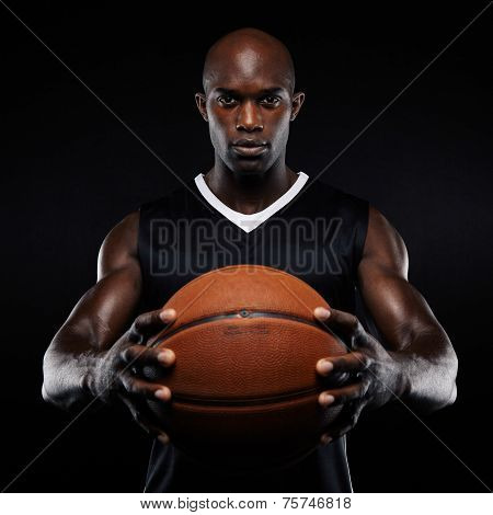 Muscular Young Basketball Player With A Ball